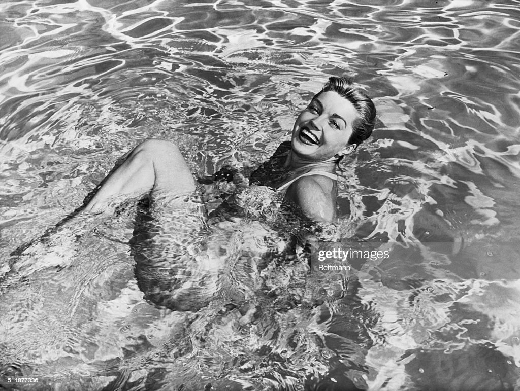 Esther Williams swimming in pool.