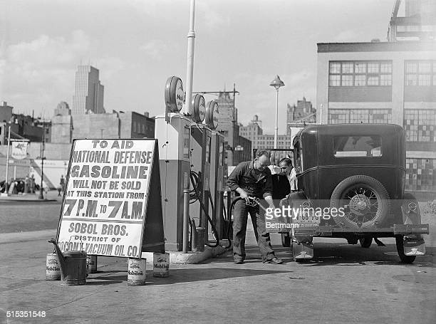 8/3/1941New York New York An automobile has just been gased up before the seven PM closing of gas stations in compliance with the Governmental...