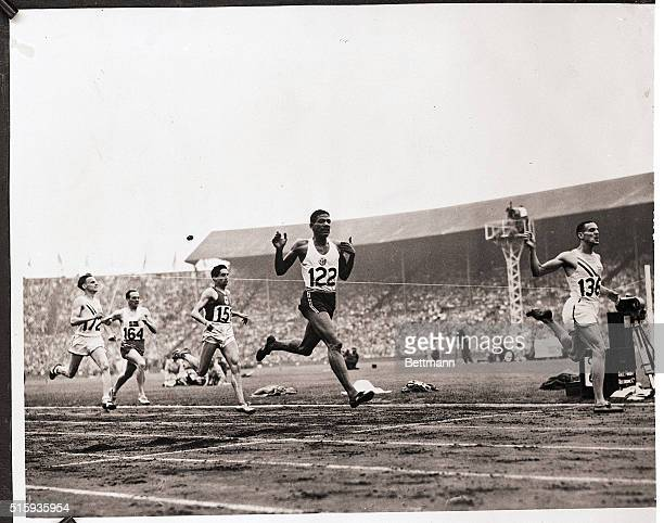 8/3/1948London England Mal Whitfield sensational American middle distance runner is shown as he crossed the finish line in the final of 800 meter...