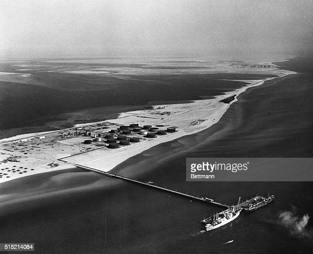 Ras Tanura, Al Hase, Saudi Arabia: A pier extending far off shore from the Ras Tanura marine terminal allows the docking of large tankers. The...