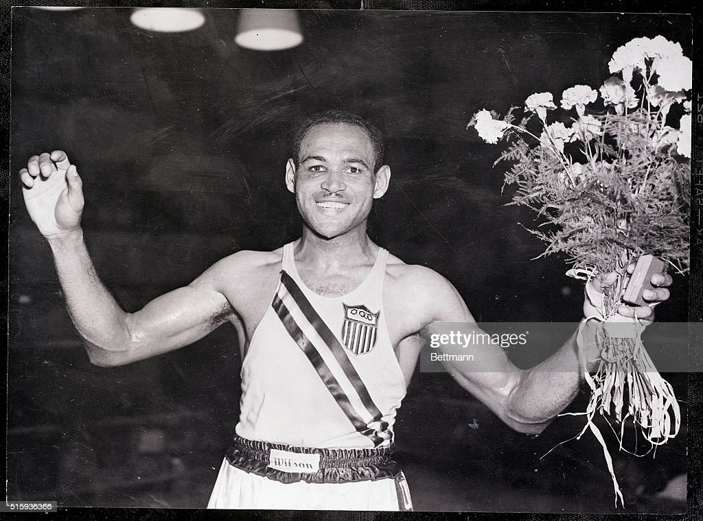 Olympic Boxer Holding Medal and Bouquet : News Photo