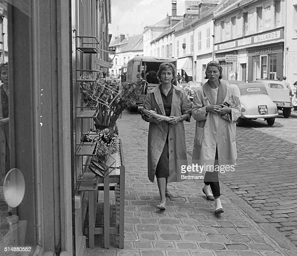 Chevreuse, France: Just like every housewife here, Swedish actress Ingrid Bergman does her shopping at teh local market with the aid of her daughter...