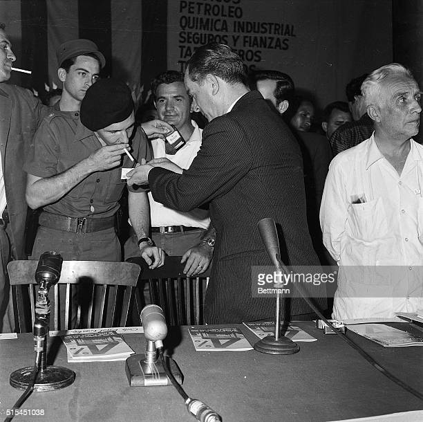8/3/1960Havana Cuba Cuban Armed Forces Minister Raul Castro gets a light for cigarette from ousted Guatemalan exPresident Jacobo Arbenz before...