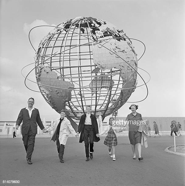 World's Fair- Woody H. Keefe and his wife Marie flank their happy children Barry Kevin and Kathy as they stroll near the Unisphere at the New York...