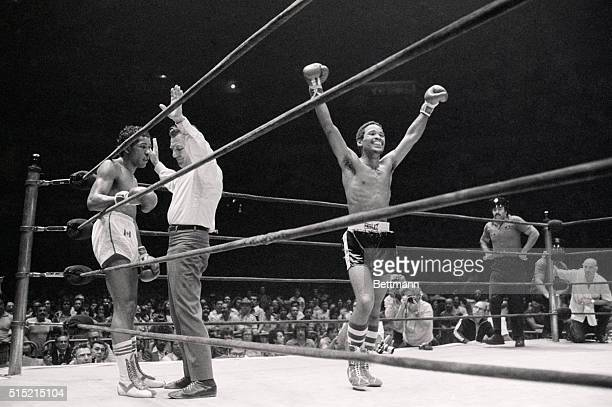 8/3/1977New York NY World junior welterweight champ Wilfredo Benitez of Puerto Rico strolls around ring with both arms raised in jubilation after...