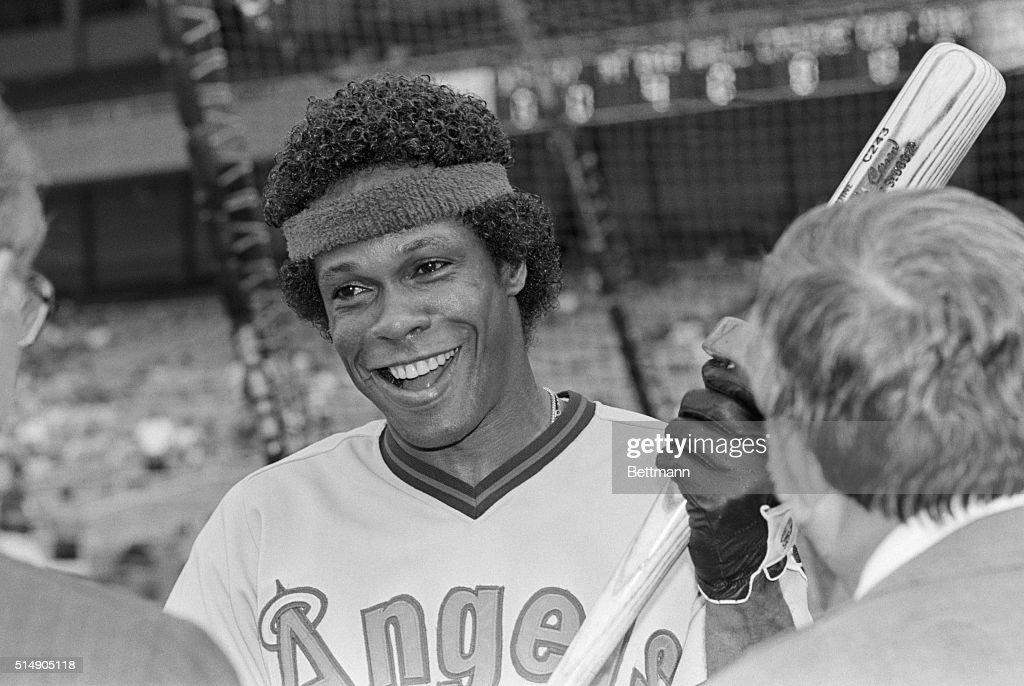 You might say that that hair styling and that smile make California Angels' Rod Carew look most angelic July 23rd at Yankee Stadium, where he's on hand for a game against the Yankees. As far as opposing pitchers are concerned, Carew has been a devil over the years. He won the American league batting championship in 1969, 1972, 1973, 1974, 1975, 1977 and 1978.