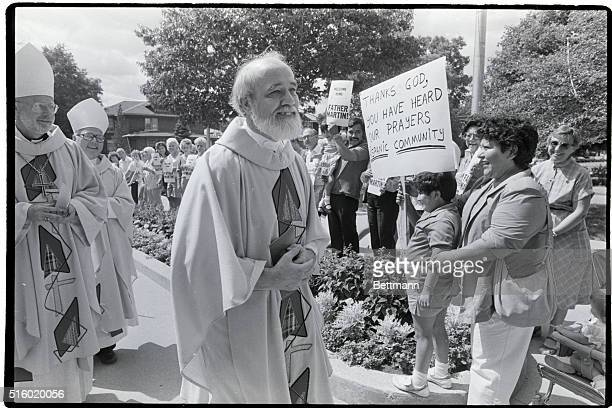 8/3/86Joliet Illinois Lawrence Jenco walks past well wishers as he enters the Cathedral of Saint Raymond in Joliet IL to celebrate his first mass...