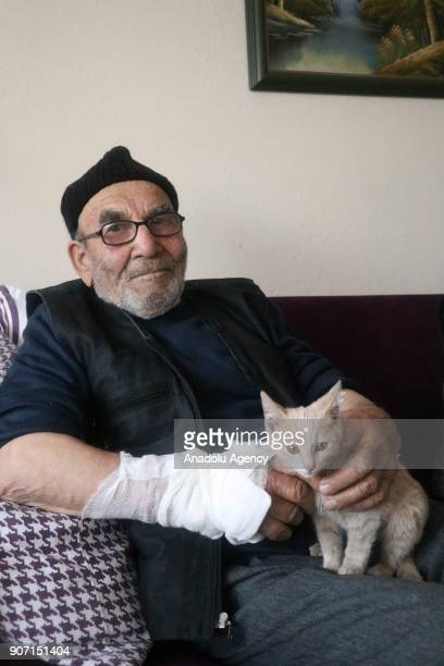 83yearold Ali Mese and the cat saved by firefighters from a fire that broke out at old man's home after he tried to light a heating stove with...