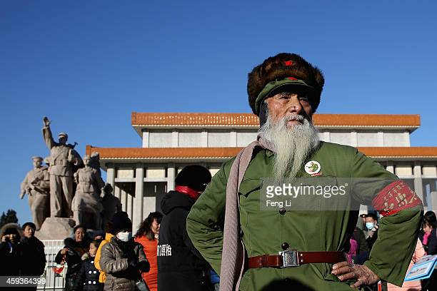 A 83yearold Chinese old man wearing the Red Guard uniform walks out Mao Zedong's maosoleum after visiting to the remains of Mao in Tiananmen Square...
