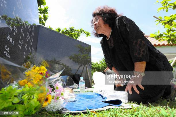 83yearold Sono Kuniyoshi sheds tears in front of the Cornerstone of Peace where the names of their bereaved family members and relatives engraved at...