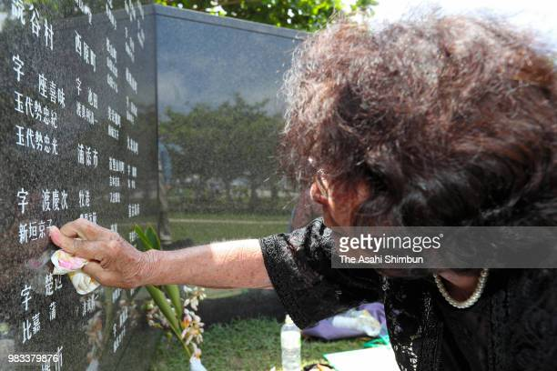 83yearold Sono Kuniyoshi sheds tears with touching the name of her younger sister at the Cornerstone of Peace where the names of their bereaved...