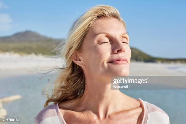840489ortrait of a mature woman enjoying the sun - hot older women stock pictures, royalty-free photos & images