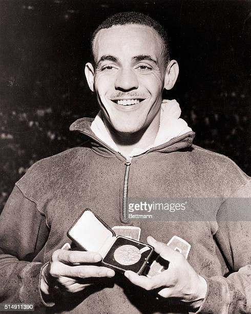 8/4/1948London England Mal Whitfield of the US displays his Gold Medal after setting a new Olympic record of 1 minute 492 seconds in the Men's...