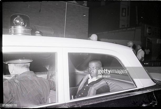8/4/1964Jersey City NJ A Negro youth bleeding from a head wound is led away by a policeman as law officers moved against small bands of hitandrun...