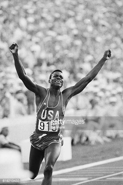 Los Angeles, CA- Carl Lewis, shown here at the finish line, gave a crowd of 92,000 the run it paid to see when he won a gold medal in the men's 100m...