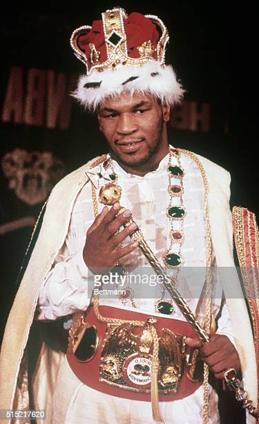 8/4/1987Mike Tyson world heavyweight boxing champ in cape and crown holding scepter