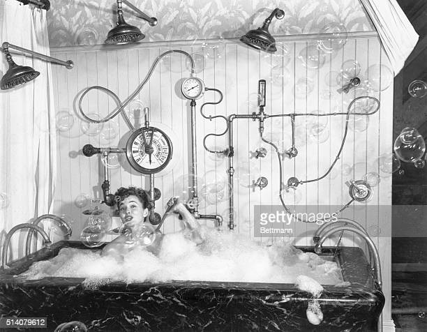 8/4/49Los Angeles California Consider this another candidate for your 'I'veseenandheardeverything' file Ann Blyth film star taking a bubble bath here...
