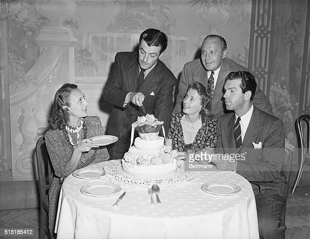 8/5/1939Hollywood CA Robert Taylor of the films cutting his birthday cake as he celebrated his 28th birthday at a dinner party given in his honor by...