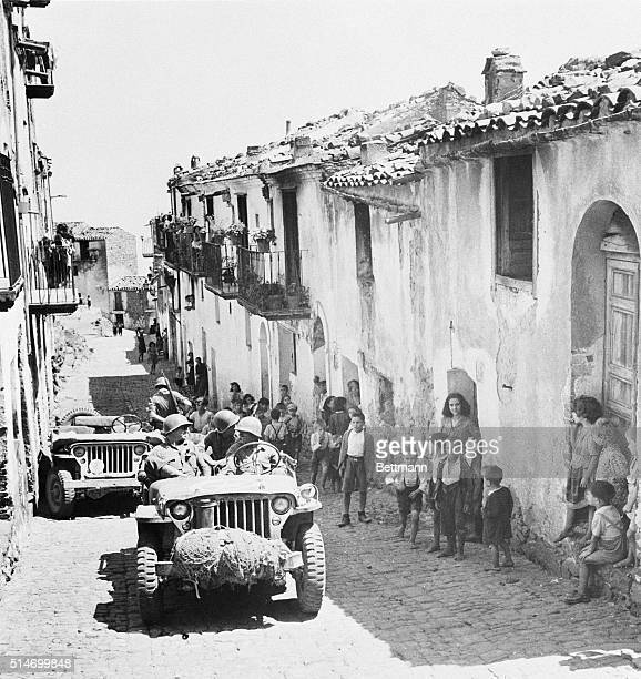 8/5/1943Sicily Italy The first American Army vehicles roll through the mountain town of Pollina after the town fell to the Allies Natives apparently...