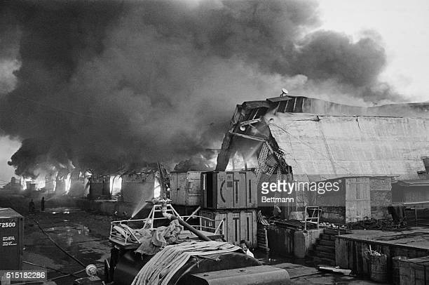 8/5/1968Manila Philippines A fire runs rampant at the pier storage area of Manila's harbor after a killer earthquake struck the city and its suburbs...