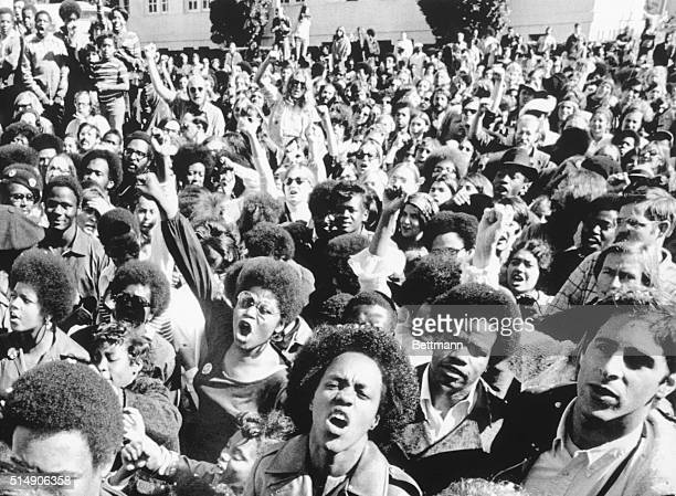 Oakland, CA- Supporters of Black Panther leader Huey Newton shout encouragement as, inside Alameda County Courthouse, Superior Court Judge Harold...