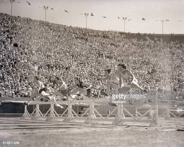 8/6/1932Los Angeles CA The sensational Mildred Babe Didrikson of Texas hurdles the barriers on her way to a world record in the 80meter hurdle event...