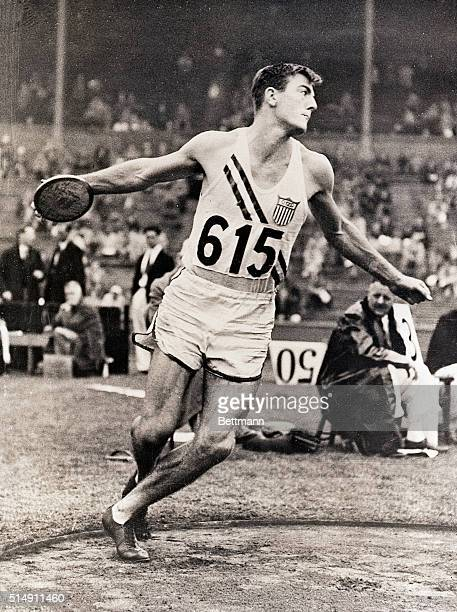 London, England- Bob Mathias is shown in action as he heaved the heavy platter in the discus throw event of the decathlon at the Olympic games. With...