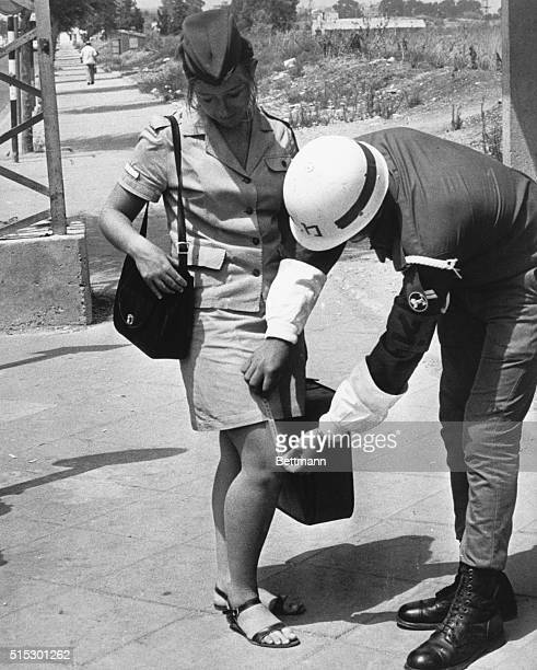 8/6/1969Tel Aviv Israel Miniskirts for Israeli girl soldiers are definitely out and this military policeman carefully checks the skirt length of a...