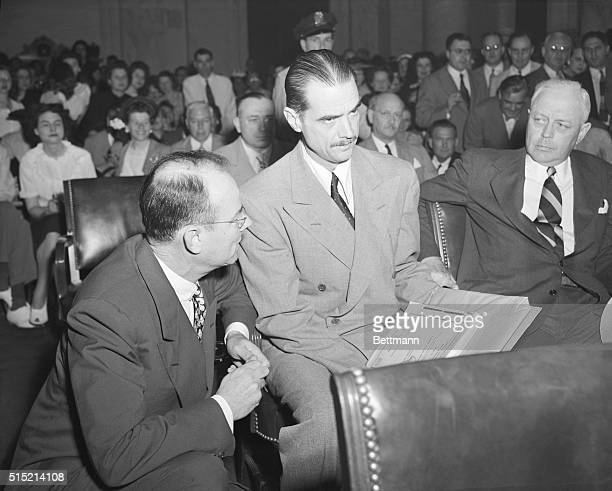 Washington, D.C.- Howard Hughes, center, charged under oath today that Sen. Owen Brewster, of ME., offered to call off the Senate probe of his...