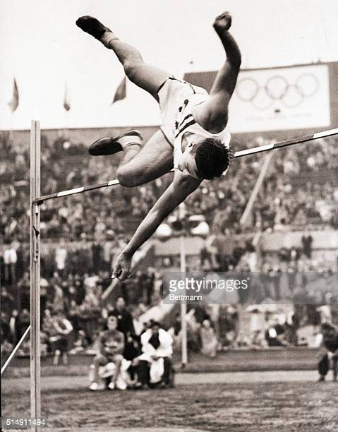8/7/1948London England Here you see Bob Mathias Topping the bar in the high jump which was a three way tie at 6 feet11/4 inches His teamate Floyd...