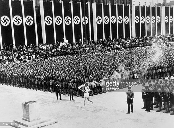 8/7/36Berlin Germany An impressive moment in the Lustgarten Berlin as the last of the 3000 runners that brought the Olympic flame from Olympia Greece...