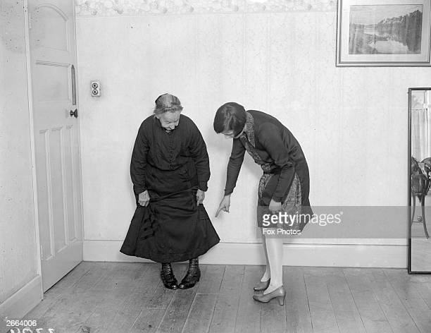 87yearold Mrs Harridine of Wood Green in London takes a Charleston lesson from Eileen Hillman in order to keep pace with the younger members of her...
