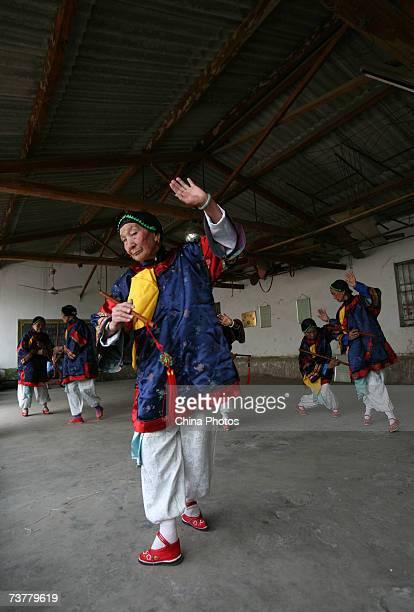 87yearold Xiao Xiuxiang member of the Bound Feet Women Dancing Team practises dancing at Liuyi Village on April 2 2007 in Tonghai County of Yunnan...