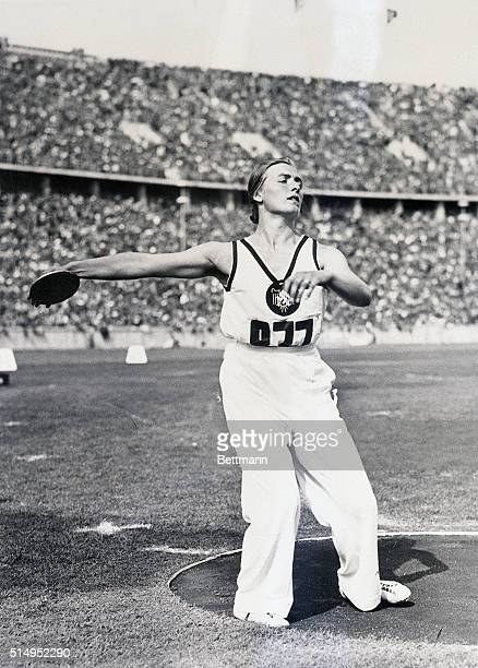 8/8/1936Berlin Germany Gisela Mauermayer of Germany is shown as she was about to toss the discus for a distance of 156 feet3 1/2 inches for a new...