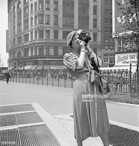 New York, NY-This woman considers the sight interesting enough to photograph. She's so intent that she doesn't realize her own picture is being taken.