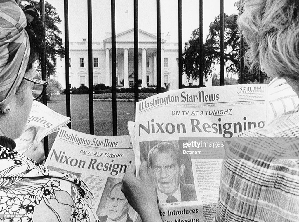 Washington, DC- Newspaper headlines being read by tourists in front of the White House tell of history in the making. It is said to be imminent that President Nixon will become the first President of the country to resign. He will address a nationwide TV audience tonight.