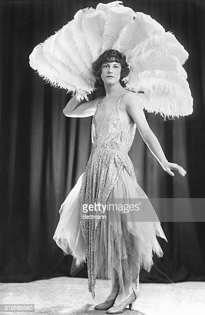 8/9/1922Smart Fashion from London An evening frock of lilac tulle with a beaded tunic The great feather fan enhances a charming evening costume
