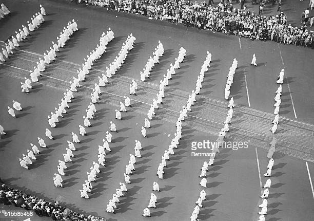 8/9/1925Washington DC Overhead view of the Ku Klux Klan parade on Pennsylvania Avenue Shows a group of women Klan members from New York State