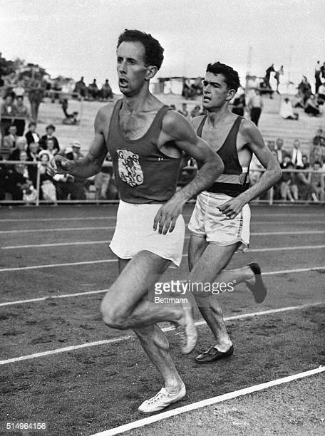 8/9/1956Melbourne Australia Just a pace behind world mile champion John Landy 19yearold Ron Clarke shown here when Landy broke the fourminute mile at...