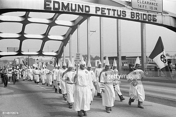 A small group of Ku Klux Klansmen led by Bill Wilkerson Imperial Wizard of the Invisible Empire from Denham Springs LA march across the Edmund Pettus...