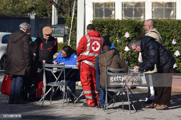 Volunteers of the Italian Red Cross register residents in the Pisano district of Zafferana Etnea near Catania on December 26 2018 after a 48magnitude...