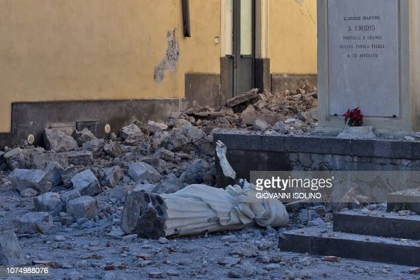 The destroyed statue of Saint Emidio known as the protector against earthquakes is pictured in Pennisi on December 26 2018 after a 48magnitude...