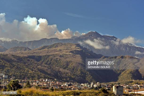 Smoke rises from Mount Etna over the city of Giarre Catania on December 26 2018 A 48magnitude earthquake struck on December 26 in the area near...