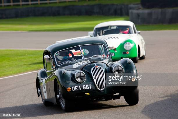 1955 Jaguar XK140 FHC driven by Andrew KeithLucas in the Fordwater Trophy race at the 20th anniversary of the Goodwood Revival at Goodwood on...