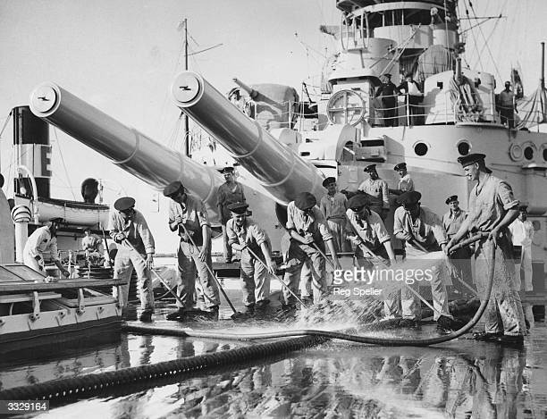 German naval ratings washing the deck of the German training ship SchleswigHolstein on arrival off Falmouth