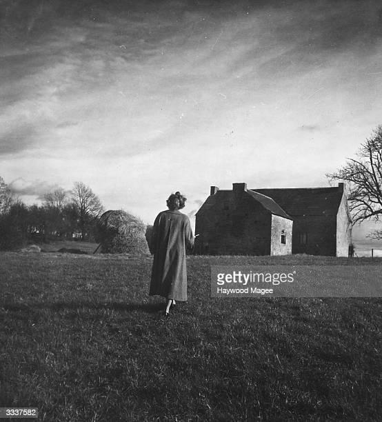 A woman walks through the grounds of an Irish castle Original Publication Picture Post 5004 Ireland's Castles Grandeur In Decline pub 1950