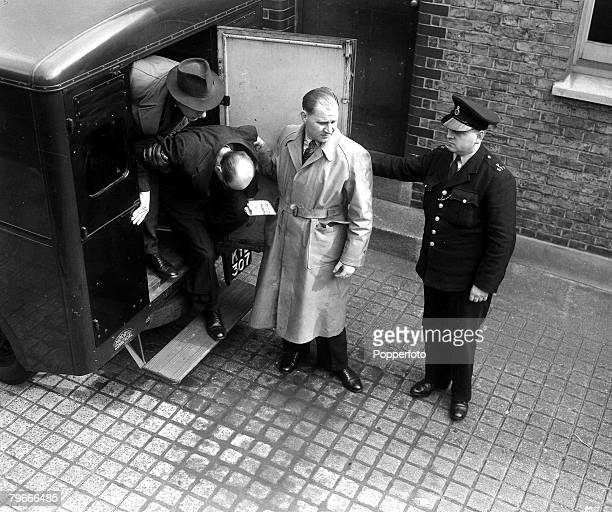 8th April 1953 Fohn Reginald Halliday Christie aged 55 arrives with head bowed at West London Magistrates court where he was accused of his wife...