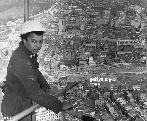 Apprentice fitter Terry Titshall 540 feet up on the scaffolding of the Post Office Tower which when complete will be London's tallest building