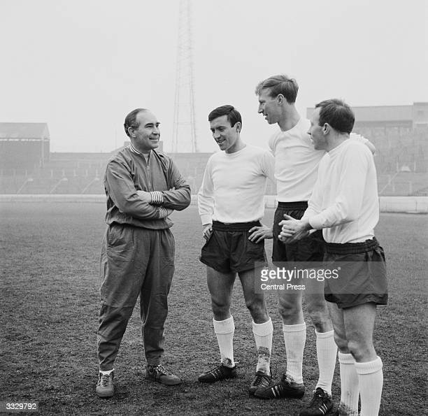 England manager Alf Ramsey chatting with three of his new team members Barry Bridges of Chelsea Jackie Charlton of Leeds United and Nobby Stiles of...