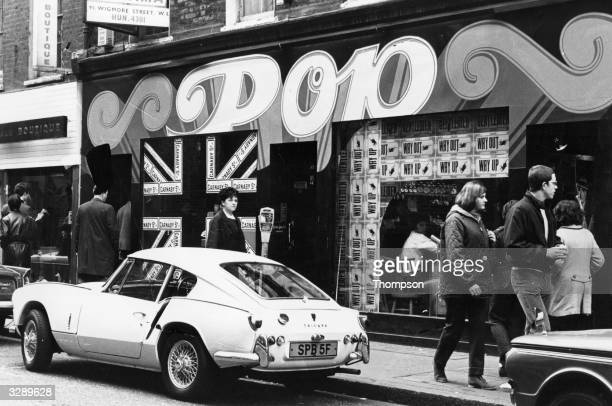 A shop called Pop on Carnaby Street in London's West End A Triumph Spitfire GT6 is parked outside